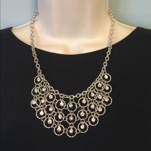Necklace: Silver tone loops with sparkles